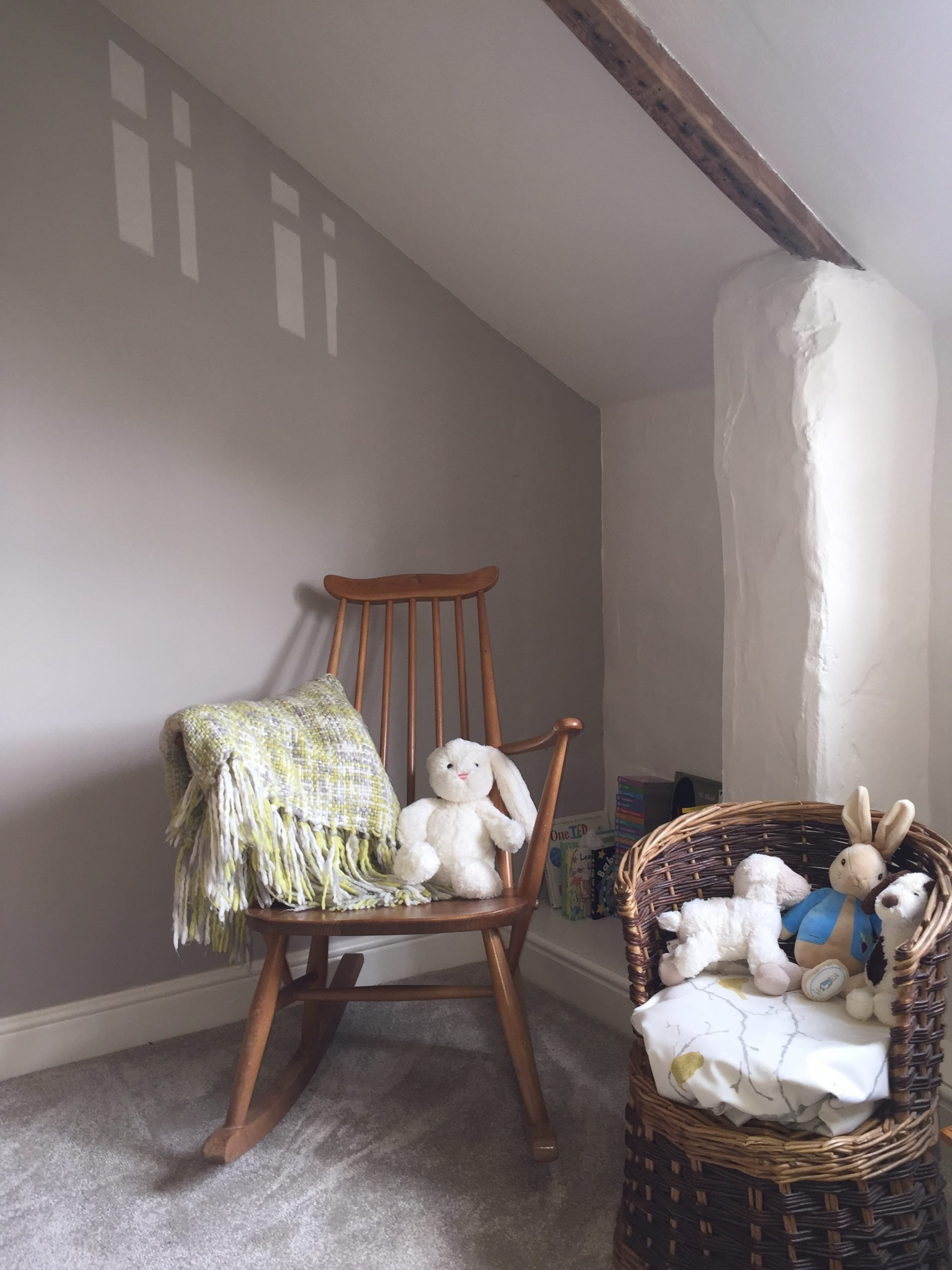 Design Penguin Portfolio Nursery corner of room with chairs